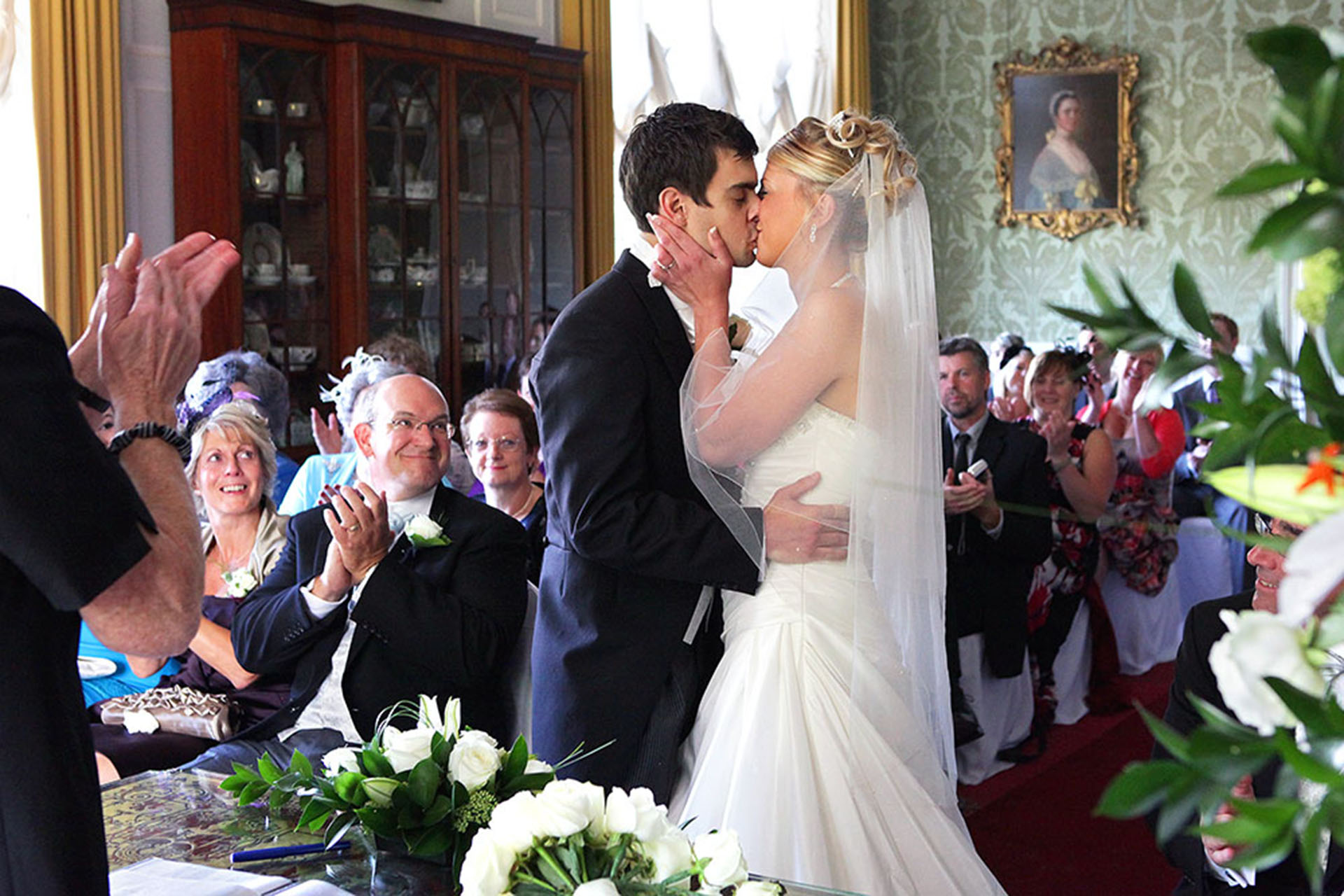 Bride and groom kissing during wedding ceremony